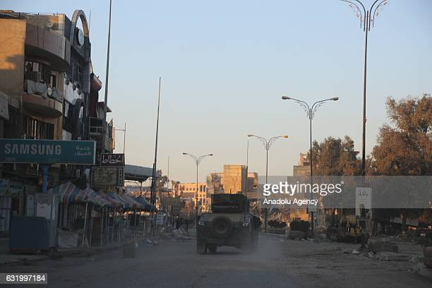 An armored vehicle belongs to Iraqi armed forces patrols the street after clashes between Iraqi army forces and Daesh terrorists at AlZuhur...