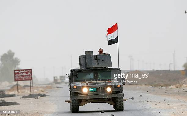 An Armored vehicle belongs to the Iraqi Army patrols at the Bertilla front as the operation to retake Iraq's Mosul from Daesh terrorists continues in...