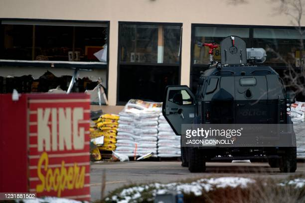 An armored vehicle is parked outside the entrance of the King Soopers grocery store in Boulder, Colorado where a mass shooting took place on March...