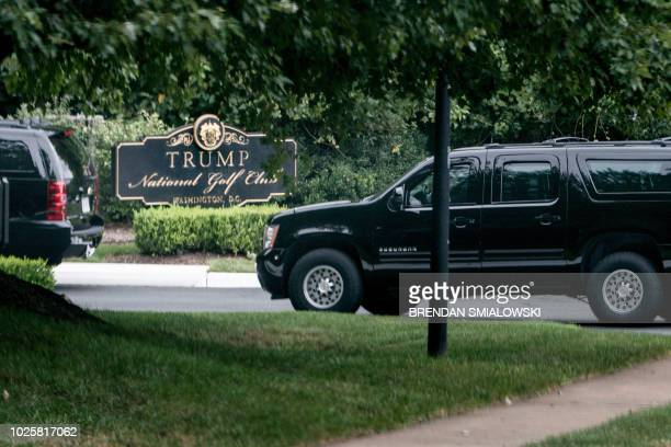 An armored vehicles arrives with US President Donald Trump at the Trump National Golf Club September 1 2018 in Sterling Virginia US President Donald...