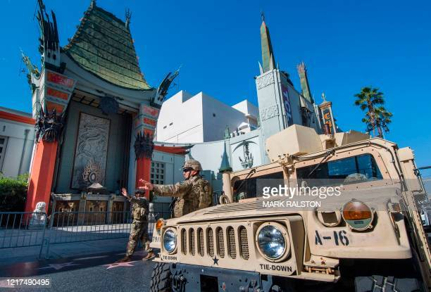 An armored vehicule is parked as the National Guard keep watch outside the TCL Chinese Theater on Hollywood Blvd after demonstrators continued to...