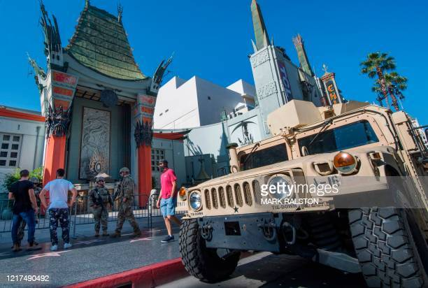 An armored vehicule is parked as the National Guard keeps watch outside the TCL Chinese Theater on Hollywood Blvd after demonstrators continued to...