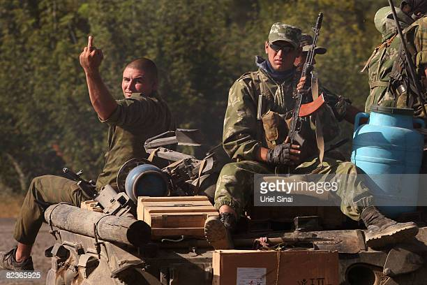 An armour part of a Russian convoy heads along the main road from Gori towards Tblisi as the tense standoff on the north of Georgia continued on...