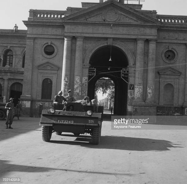 An armoured car of the Wiltshire Regiment leaving City Police headquarters on a peacekeeping patrol after communal riots in Amritsar Punjab during...