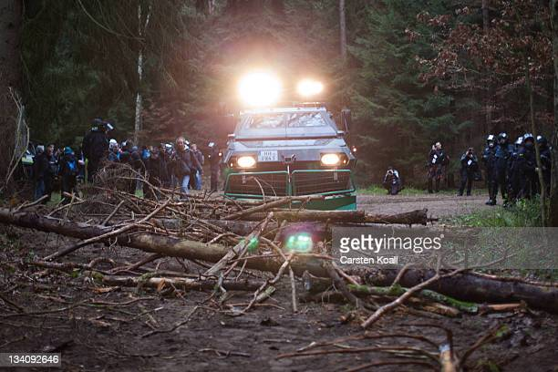An armoured carrier removes logs laid on the road by antinuclear demonstrators on November 25 2011 in Leitstade near Metzingen Germany A train...