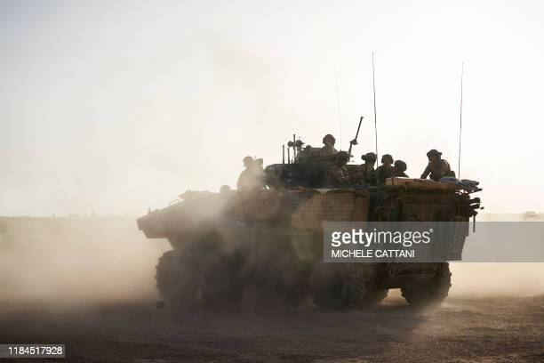 An Armoured Personnel Carrier of the French Army patrols a rural area during the Bourgou IV operation in northern Burkina Faso along the border with...