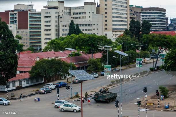 An armoured personnel carrier stations at an intersection as Zimbabwean soldiers regulate traffic in Harare on November 15 2017 Zimbabwe's military...