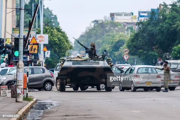 TOPSHOT An armoured personnel carrier stations by an intersection as Zimbabwean soldiers regulate traffic in Harare on November 15 2017 Zimbabwe's...