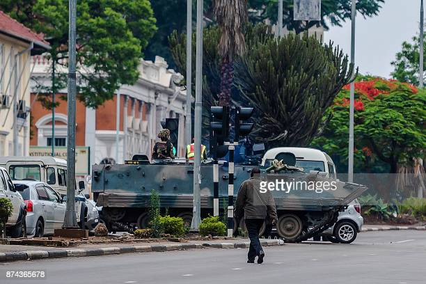 An armoured personnel carrier stations by an intersection as Zimbabwean soldiers regulate traffic in Harare on November 15 2017 Zimbabwe's military...