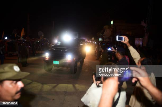 An armoured vehicle allegedly carrying former Pakistan premier Nawaz Sharif and his daughter Maryam Nawaz arrives in Adiala prison in Rawalpindi near...