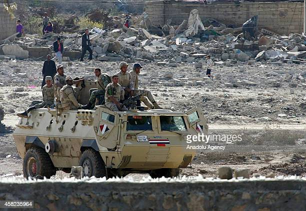 An armoured vehicle of Egyptian army is seen as they blow up buildings as part of an operation aiming to create a buffer zone at the Rafah border in...