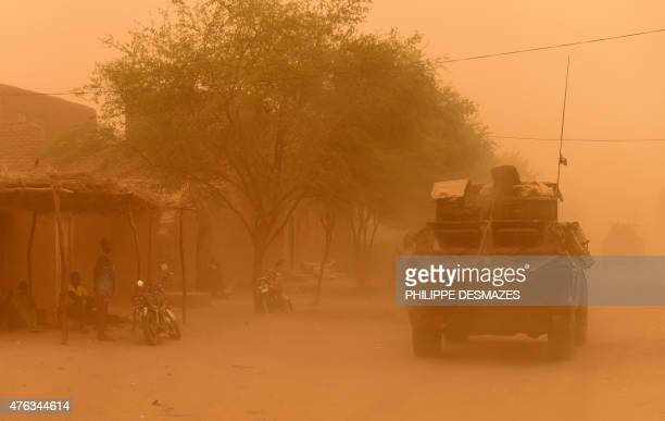 An armoured vehicle of the French 93rd Mountain Artillery Regiment leaves on June 3 2015 in Goundam in the Timbuktu region northern Mali during a...