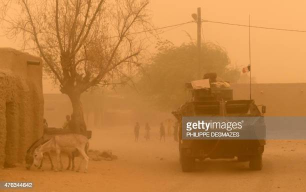 An armoured vehicle of the French 93rd Mountain Artillery Regiment leaves Goundam on June 3 2015 in the Timbuktu region northern Mali during a joint...