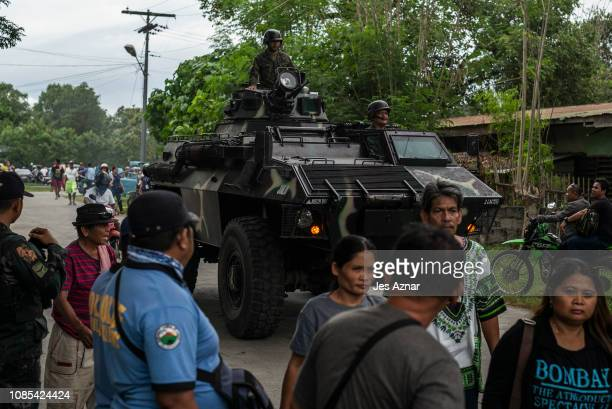 An armoured vehicle rolls out on a street as residents trooped to a local gymnasium to watch the boxing fight of Manny Pacquio and Adrien Broner on...