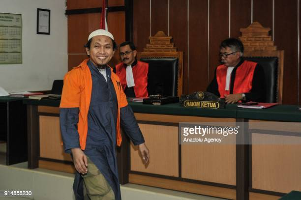 An arms smuggler for the Indonesian terrorist network from the southern Philippines, Suryadi Mas'ud enters the courtroom at the West Jakarta District...