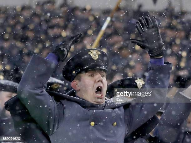 An Army Black Knights cadet celebrates the win over the Navy Midshipmen on December 9 2017 at Lincoln Financial Field in Philadelphia PennsylvaniaThe...