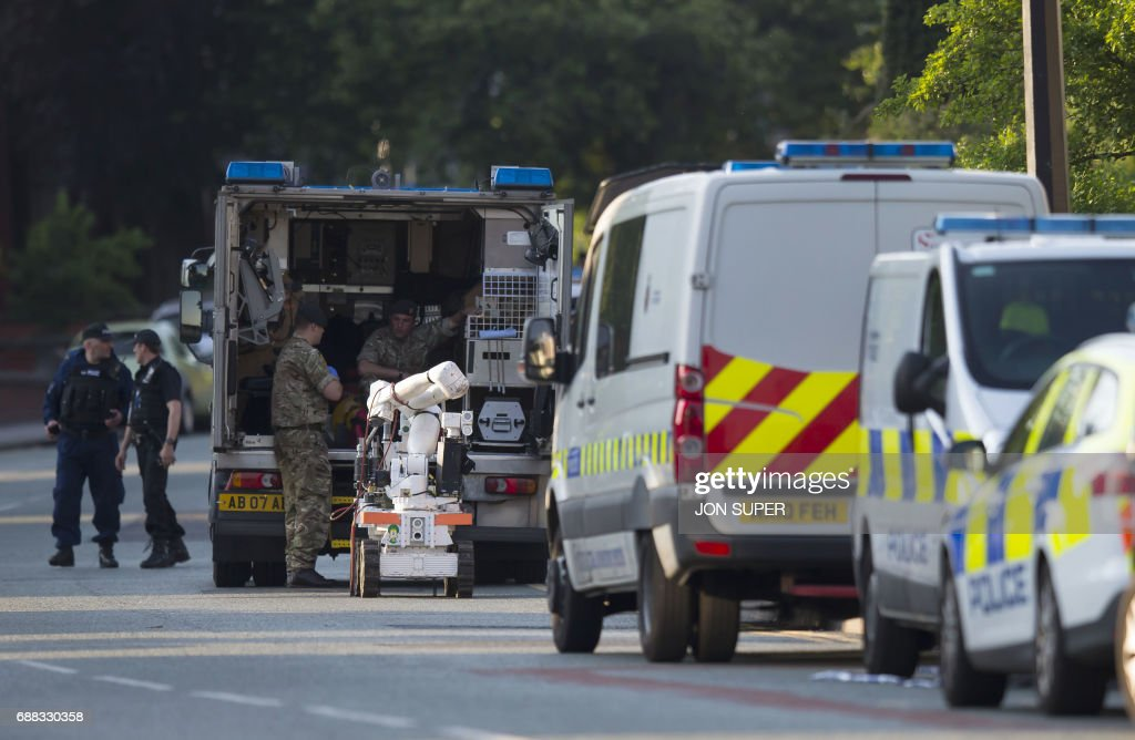 TOPSHOT - An army bomb disposal unit is parked nearby during a security operation at Springfield Street in Wigan, Greater Manchester on May 25, 2017. / AFP PHOTO / Jon Super / JON