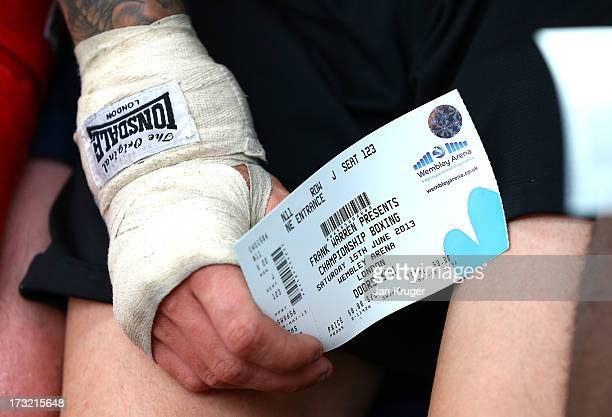 An Army boxer from the Grenadier Guards holds a ticket during a Dereck Chisora media workout as he prepares for his showdown with undefeated Malik...