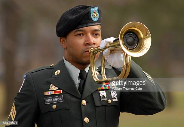 An Army bugler plays Taps during burial services for Maj John Pryor MD of Moorestown New Jersey at Colestown Cemetery January 5 2009 in Cherry Hill...
