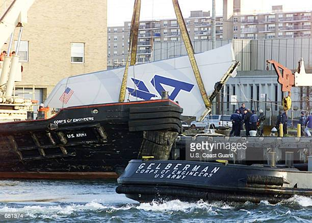 An Army Corps of Engineers vessel lifts a piece of American Airlines flight 587 from Jamaica Bay November 12 2001 in Queens New York Coast Guard...