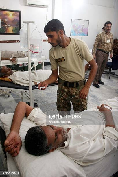 An Army doctor examines a patient who was affected by the heatwave at heat strokes centre in Karachi on June 23 2015 The death toll from a threeday...