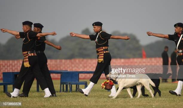 An Army dog carries flower bouquet to pay floral tribute to the martyrs of 1971 war at Royal Calcutta Turf Club on December 14 2018 in Kolkata India...