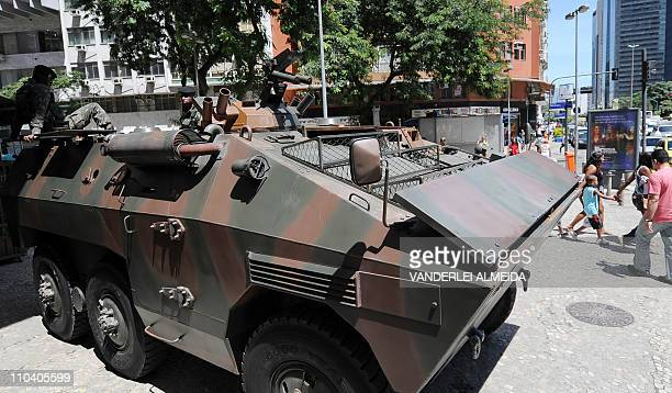 An army EE11 Urutu armoured personnel carrier stays in position on the security perimeter around the Municipal Theatre from where US President Barack...