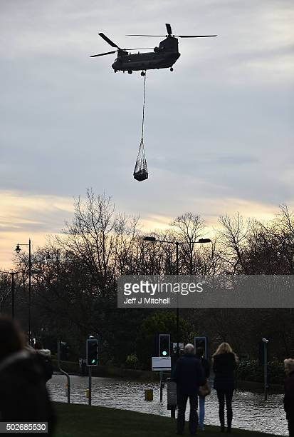 An army helicopter assists with the flood relief effort after the River Foss burst its banks on December 28 2015 in York United Kingdom United...