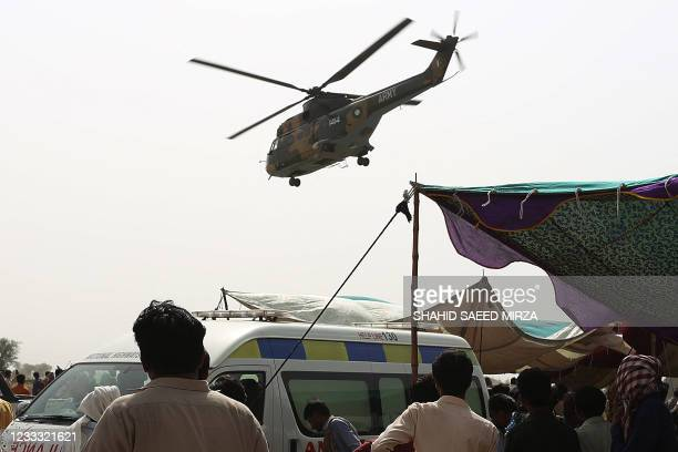 An army helicopter carrying injured passengers takes off from the site of a train accident in Daharki area of the northern Sindh province on June 7...