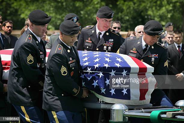 An Army honor guard carries the remains of US Army PFC Michael Olivieri of Homer Glen Illinois to his gravesite at Abraham Lincoln National Cemetery...