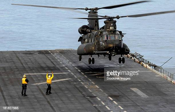 An Army MH-47G Chinook conducts deck landing qualifications.
