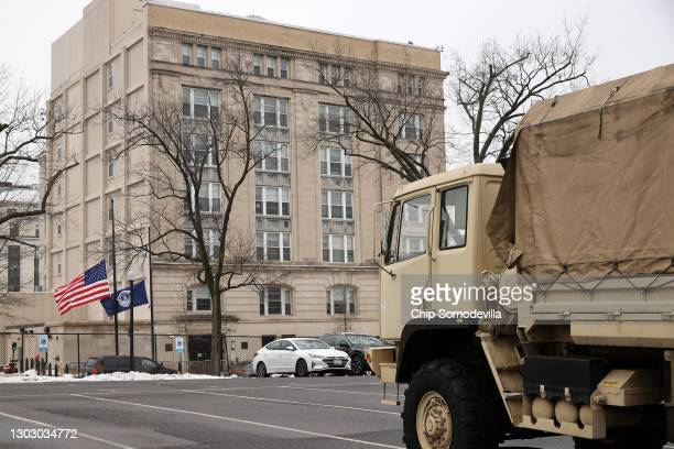 An Army National Guard truck is parked in a lot across from the United States Capitol Police headquarters on February 19, 2021 in Washington, DC. The...