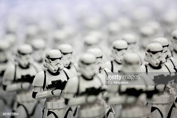 An army of Stormtrooper figurines stands on display in an exhibitor booth during the 45th annual San Diego ComicCon on July 24 2014 in San Diego...