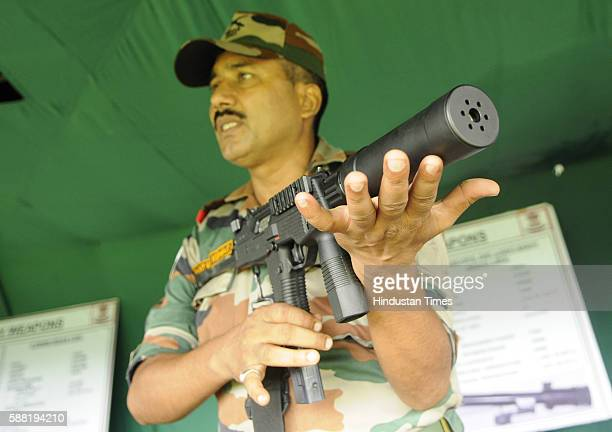 An army officer is showing a Swiss made SMG MP 9mm machine pistol during 'Know Your Army' Exhibition at Saltlake SectV on August 10 2016 in Kolkata...