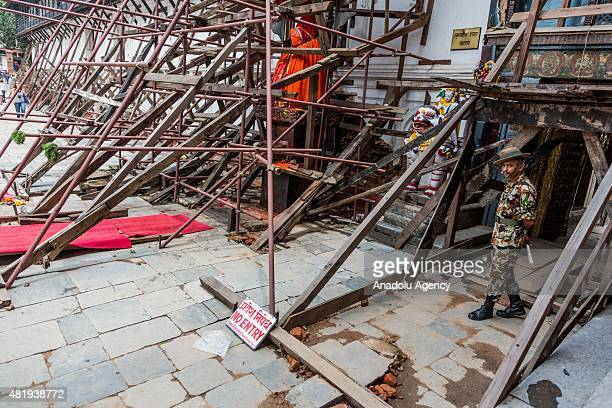 An army officer on guard at an entrance of a temple inside Durbar Square Kathmandu on July 25, 2015. Today marks the 3 month anniversary of the Nepal...