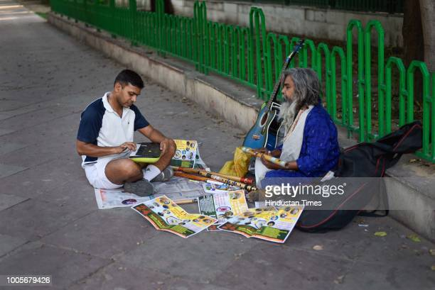 An Army Officer plays keyboard on a footpath as he has been joining and getting classes from Guitar Rao ever since he has made a music set up on a...