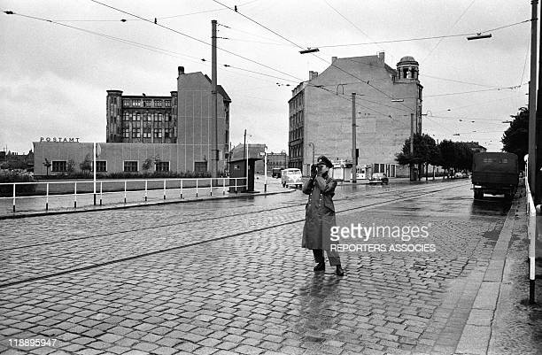 An army officer scans the area with binoculars during the Mayor of Berlin Willy Brandt's speech after the beginning of construction of the Berlin...