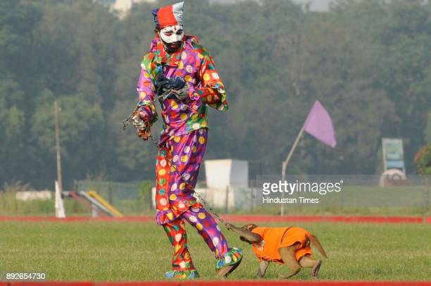 An Army person dressed as clown with his monkey during 46th anniversary of Vijay Diwas at RCTC ground on December 14 2017 in Kolkata India Vijay...