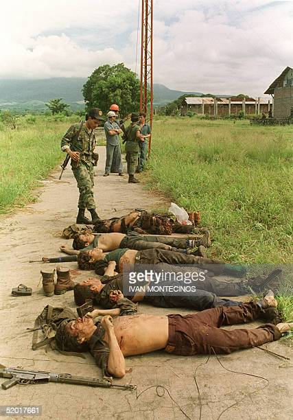 An army soldier looks at bodies of five guerillas killed during a fight with soldiers in the center of Algodonero 60km southeast of the capital 26...