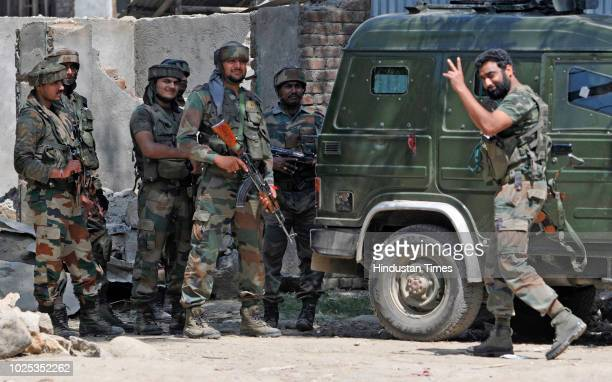 An army soldier shows victory sign after killing two militants on August 30 2018 in Hajin some 40 kilometres north of Srinagar India Jammu and...