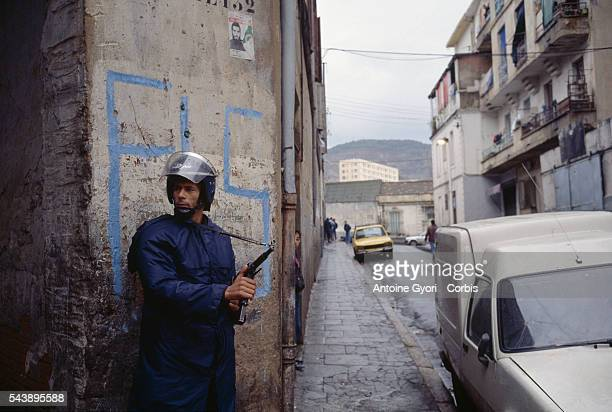 An army soldier with the Algerian armed forces patrols a street in Algiers during the political crises which stemmed from the general elections. On...