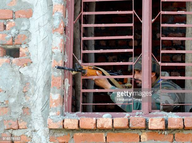An army soldiers takes position at a site of gunbattle at Sunjuwan Military station on February 10 2018 in Jammu India Militants attacked an army...