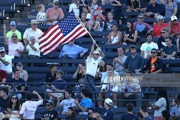 An Army supporters runs around the stadium with a USA Stars and Stripes flag during the Yale V Army Football match at Yale Bowl New Haven Yale won...