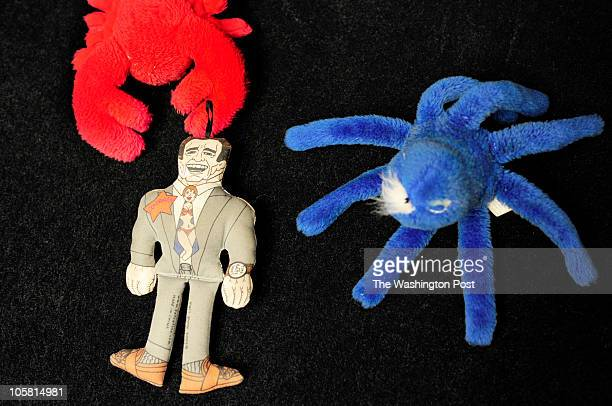 An Arnold Schwarzenegger dog toy among others litters the office floor of Rep Jerry Lewis who brings his male bichon / poodle Bruin that he brings to...