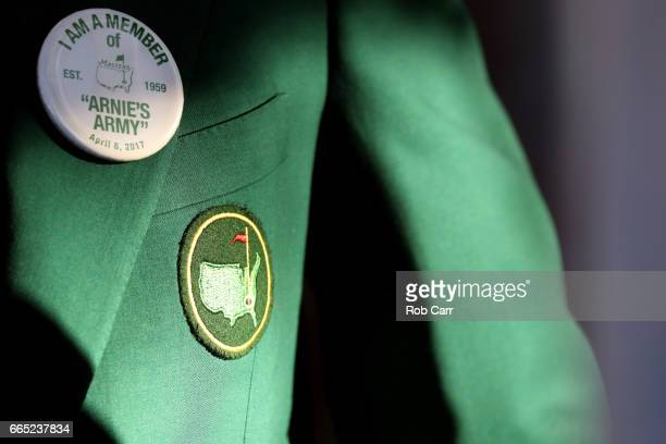 "An ""Arnold's Army"" pin is displayed on a Green Jacket during the first round of the 2017 Masters Tournament at Augusta National Golf Club on April 6,..."