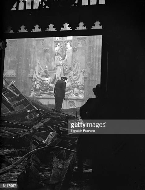 An ARP warden inspecting bomb damage in a church.