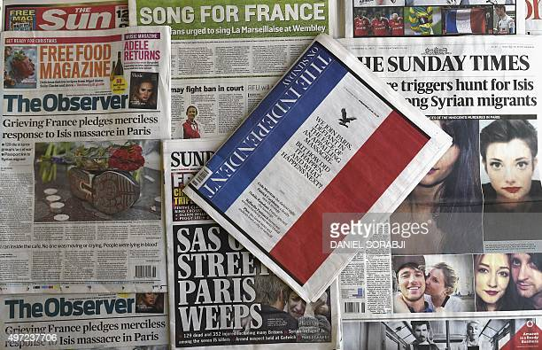 An arrangement of British newspapers photographed in London on November 15 2015 shows the front pages dominated by reports on the wave of terror...