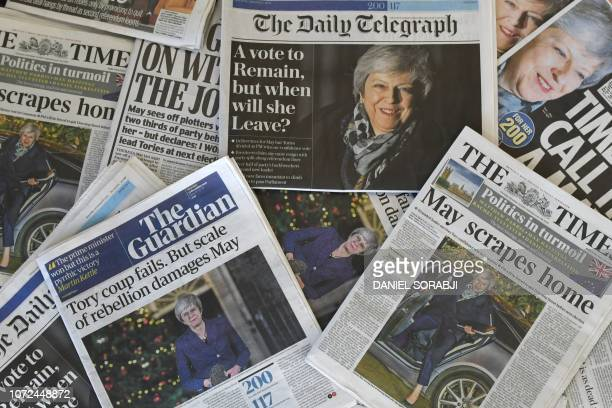An arrangement of British newspapers showing front page stories reporting the result of the Conservative Party confidence vote in the leadership of...
