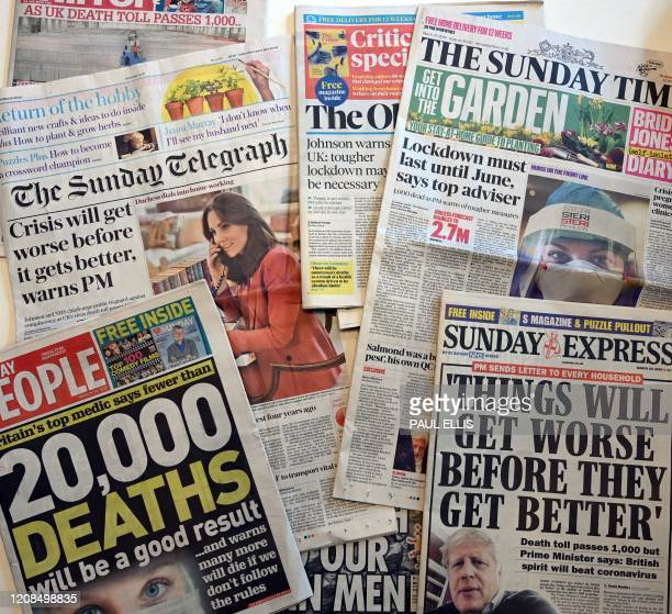 An arrangement of British Sunday newspapers photographed as an illustration in Liverpool, north west England on March 29 shows the front page stories...