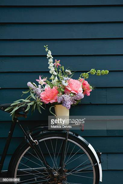 An arrangement of flowers on the back of a bicycle